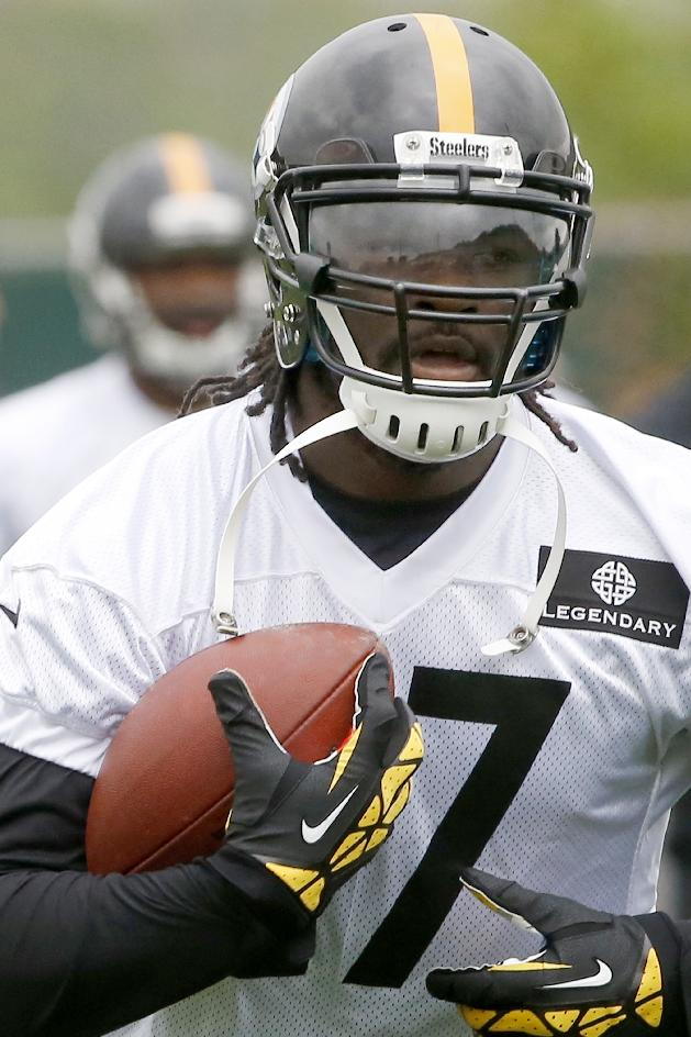 In this May 29, 2014, file photo, Pittsburgh Steelers running back LeGarrette Blount (27) carries a ball during an NFL football organized team activity in Pittsburgh. Steelers running backs Le'Veon Bell and Blount will be charged with marijuana possession following a traffic stop Wednesday afternoon, Aug. 20, 2014, near Pittsburgh. Ross Township detective Brian Kohlhepp said traffic officer Sean Stafiej pulled over a Camaro operated by Bell around 1:30 p.m. after Stafiej, who was on a motorcycle, noticed a strong odor of marijuana coming from the vehicle. Stafiej found a 20 gram bag of marijuana inside the car. Bell, Blount and a female passenger all claimed ownership of the marijuana according to police