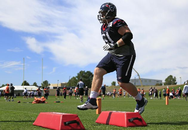 Houston Texans guard Bronson Irwin runs a drill during a joint practice with the Denver Broncos on Thursday, Aug. 21, 2014, in Englewood, Colo