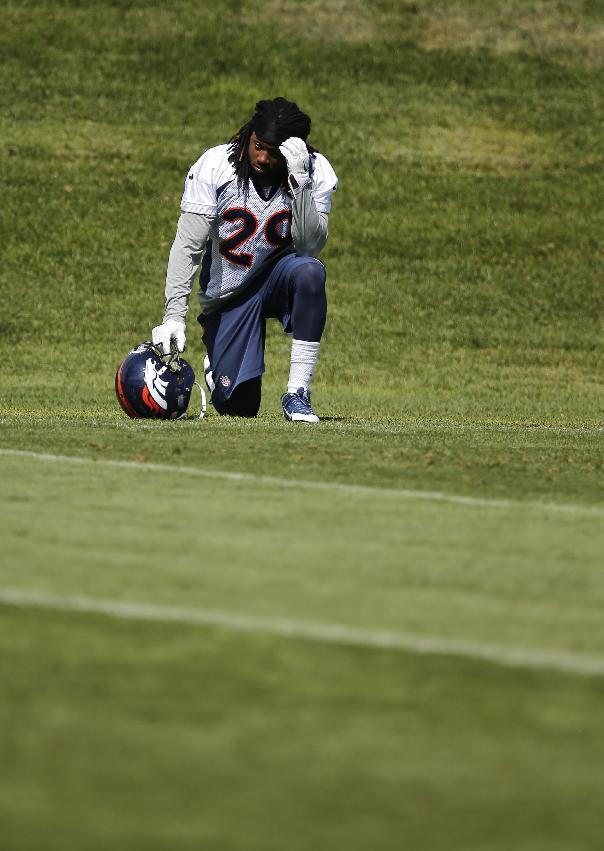 Denver Broncos cornerback Bradley Roby watches teammates run a drill from the sidelines during a joint practice  with the Houston Texans on Thursday, Aug. 21, 2014, in Englewood, Colo