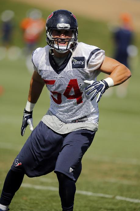 Houston Texans linebacker Mike Mohamed runs a drill during a joint practice  with the Denver Broncos on Thursday, Aug. 21, 2014, in Englewood, Colo