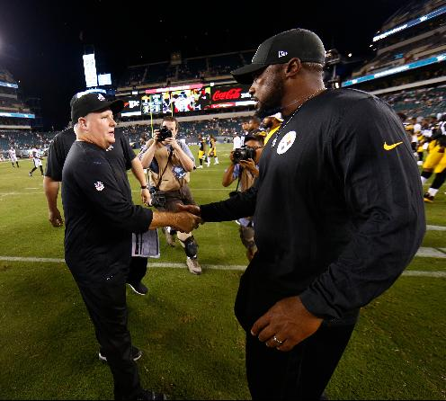 Philadelphia Eagles head coach Chip Kelly, left, meets with Pittsburgh Steelers head coach Mike Tomlin after an NFL preseason football game, Thursday, Aug. 21, 2014, in Philadelphia. Philadelphia won 31-21