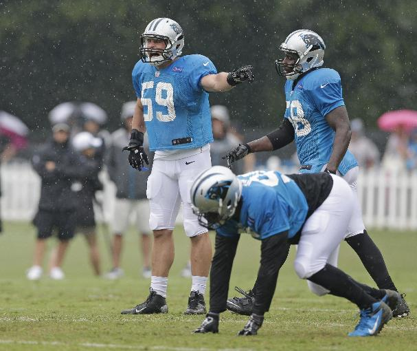 In this July 31, 2014, photo Carolina Panthers' Luke Kuechly (59) leads the defense during an NFL football practice at their training camp in Spartanburg, S.C. The AP's Defensive Player of the Year in 2013, Kuechly is considered by Panthers coach Ron Rivera the team's