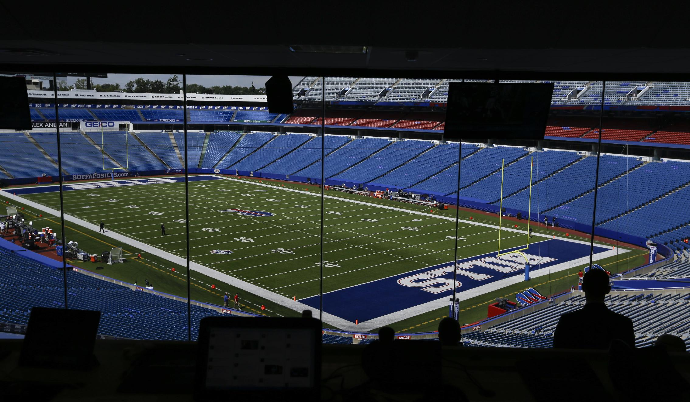 People observe the field at Ralph Wilson Stadium before a preseason NFL football game between the Buffalo Bills and the Tampa Bay Buccaneers Saturday, Aug. 23, 2014, in Orchard Park, N.Y