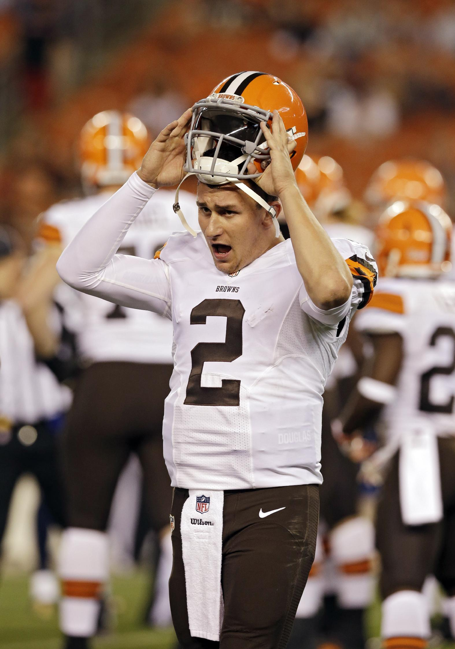 In this Aug. 23, 2014, photo, Cleveland Browns backup quarterback Johnny Manziel comes to the sidelines during a preseason NFL football game against the St. Louis Rams in Cleveland. Starting quarterback Brian Hoyer didn't change the opinion of some who feel rookie Manziel should be starting