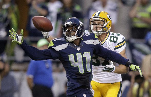 Seattle Seahawks cornerback Byron Maxwell (41) breaks up a pass intended for Green Bay Packers wide receiver Jordy Nelson (87) during the second half of an NFL football game, Thursday, Sept. 4, 2014, in Seattle