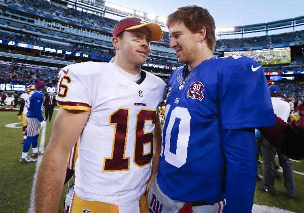Washington Redskins quarterback Colt McCoy (16) greets New York Giants quarterback Eli Manning (10) after the Giants won 24-13 in an NFL football game, Sunday, Dec. 14, 2014, in East Rutherford, N.J