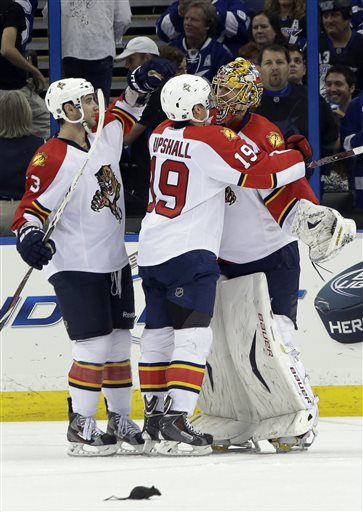 Florida Panthers goalie Jacob Markstrom, of Sweden, right, celebrates with teammates T.J. Brennan, left, and Scottie Upshall after the team defeated the Tampa Bay Lightning 5-3 during an NHL hockey game Saturday, April 27, 2013, in Tampa, Fla. 