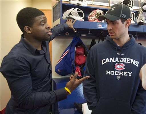 Montreal Canadiens goaltender Carey Price chats with teammate P.K. Subban, left, as the team clears out their lockers on Saturday, May 11, 2013 in Brossard, Quebec. The Canadiens were ousted by to Ottawa Senators in the first round of the NHL hockey Stanley Cup playoffs