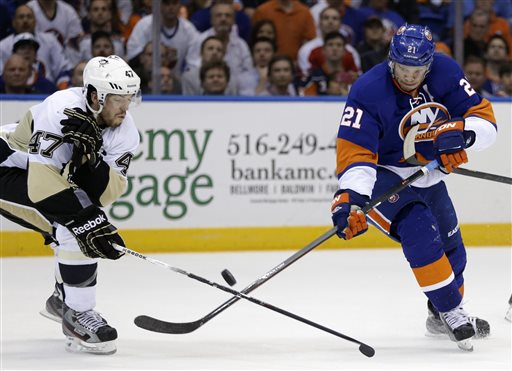 Pittsburgh Penguins' Simon Despres (47) defends New York Islanders right wing Kyle Okposo (21) in the second period of Game 6 of a first-round NHL Stanley Cup playoff hockey series, in Uniondale, N.Y., Saturday, May 11, 2013