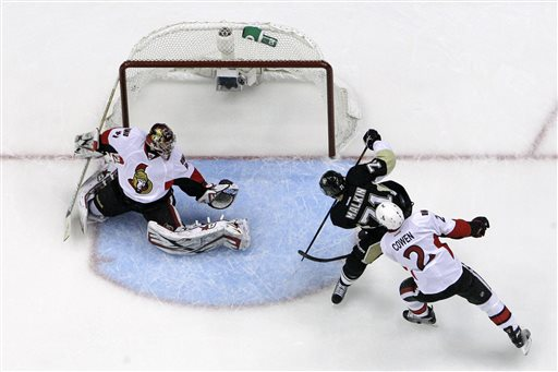 Pittsburgh Penguins' Evgeni Malkin (71) puts the puck behind Ottawa Senators goalie Craig Anderson (41) with Ottawa Senators'  Jared Cowen (2) coming late to the play during the first period of Game 1 of an NHL hockey Stanley Cup second-round playoff series against the Ottawa Senators in Pittsburgh, Tuesday, May 14, 2013. The Penguins won 4-1