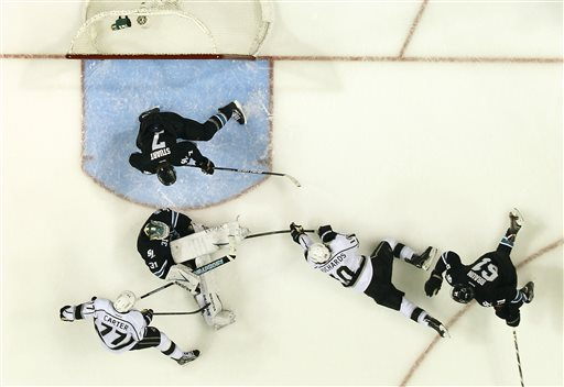 San Jose Sharks goalie Antti Niemi (31), of Finland, blocks a goal attempt against Los Angeles Kings center Mike Richards (10) as San Jose Sharks defenseman Justin Braun (61) and San Jose Sharks defenseman Brad Stuart (7) defends during the second period in Game 3 of their second-round NHL hockey Stanley Cup playoff series, Saturday, May 18, 2013, in San Jose, Calif
