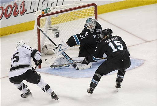 San Jose Sharks goalie Antti Niemi (31), of Finland, blocks a goal attempt against Los Angeles Kings left wing Dustin Penner (25) as San Jose Sharks center James Sheppard (15) defends during the third period in Game 3 of their second-round NHL hockey Stanley Cup playoff series, Saturday, May 18, 2013, in San Jose, Calif