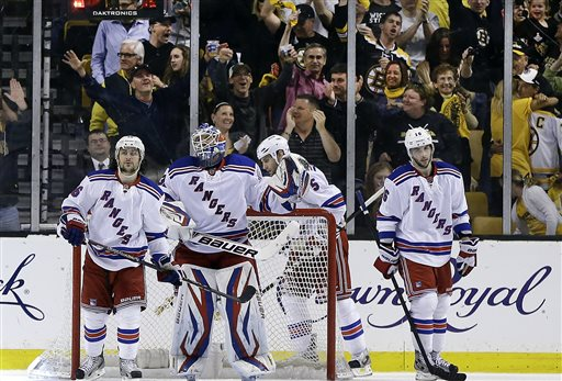 New York Rangers goalie Henrik Lundqvist, second from left, and teammates right wing Mats Zuccarello (36), defenseman Dan Girardi (5) and center Derick Brassard (16) react after the Boston Bruins scored their fifth goal during the third period in Game 2 of the NHL Eastern Conference semifinal hockey playoff series in Boston, Sunday, May 19, 2013. The Bruins won 5-2