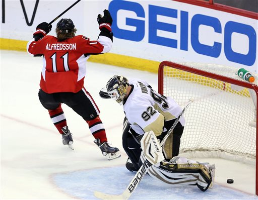 Ottawa Senators' Daniel Alfredsson (11) celebrates as he scores on Pittsburgh Penguins goaltender Tomas Vokoun (92) during the third period of Game 4 of the Eastern Conference Stanley Cup semifinal NHL hockey series on Sunday, May 19, 2013, in Ottawa
