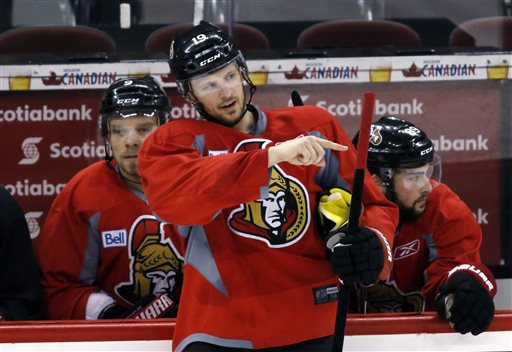 Ottawa Senators Jason Spezza stands in front of Milan Michalek, left, and Cory Conacher, right, during the team's practice ahead of Game 5 in their NHL hockey Stanley Cup playoffs Eastern Conference semifinal against the Pittsburgh Penguins in Ottawa, Ontario, on Tuesday, May 21, 2013