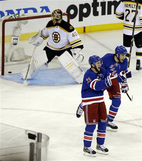 New York Rangers' Taylor Pyatt, right, and teammate Derek Stepan (21) celebrate after Pyatt scored a goal against Boston Bruins goalie Tuukka Rask (40), of Finland, during the second period in Game 3 of the Eastern Conference semifinals in the NHL hockey Stanley Cup playoffs Tuesday, May 21, 2013, in New York