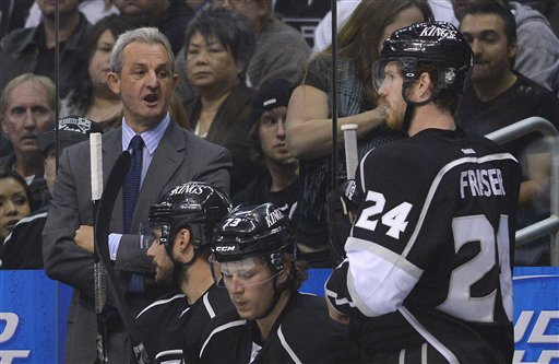 Los Angeles Kings coach Darryl Sutter, left, comments to center Colin Fraser (24) in the first period during Game 5 of the Western Conference semifinals in the NHL hockey Stanley Cup playoffs, Thursday, May 23, 2013, in Los Angeles