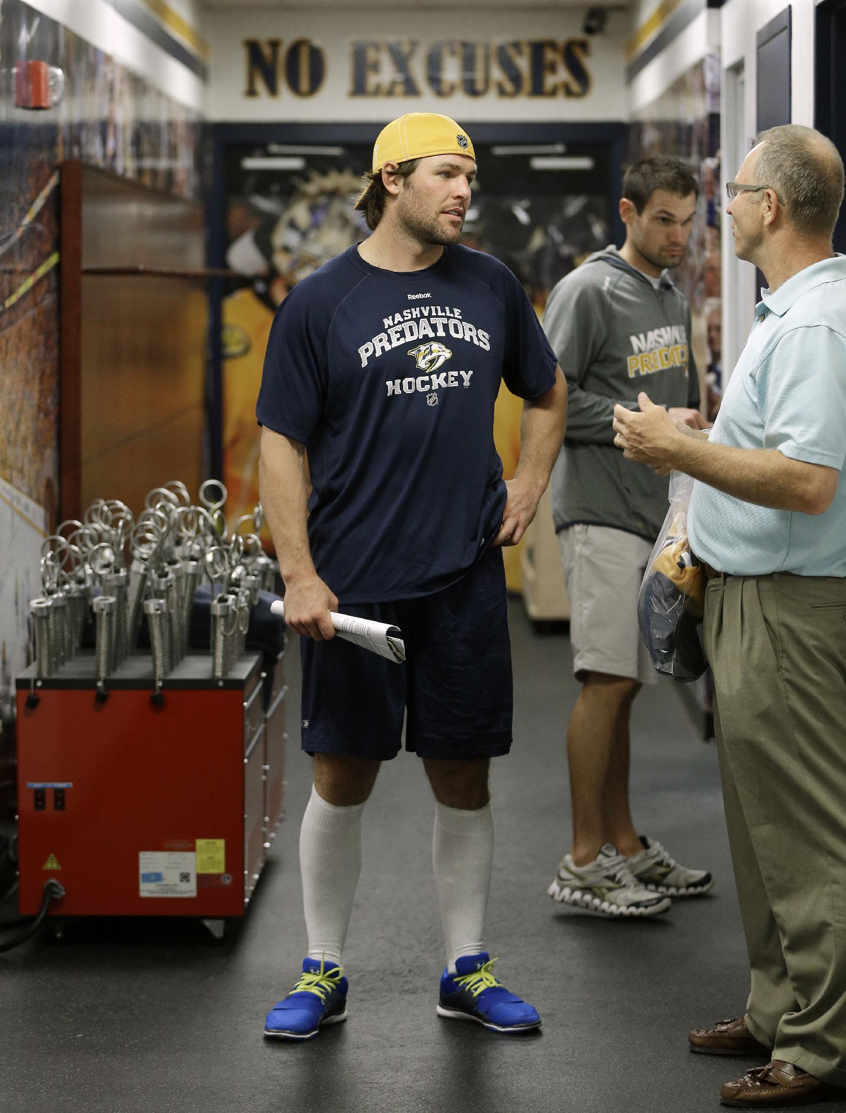 Nashville Predators center Mike Fisher, left, talks outside the locker room on the first day of NHL hockey training camp Wednesday, Sept. 11, 2013, in Nashville, Tenn. The team will try to bounce back from a rare losing season