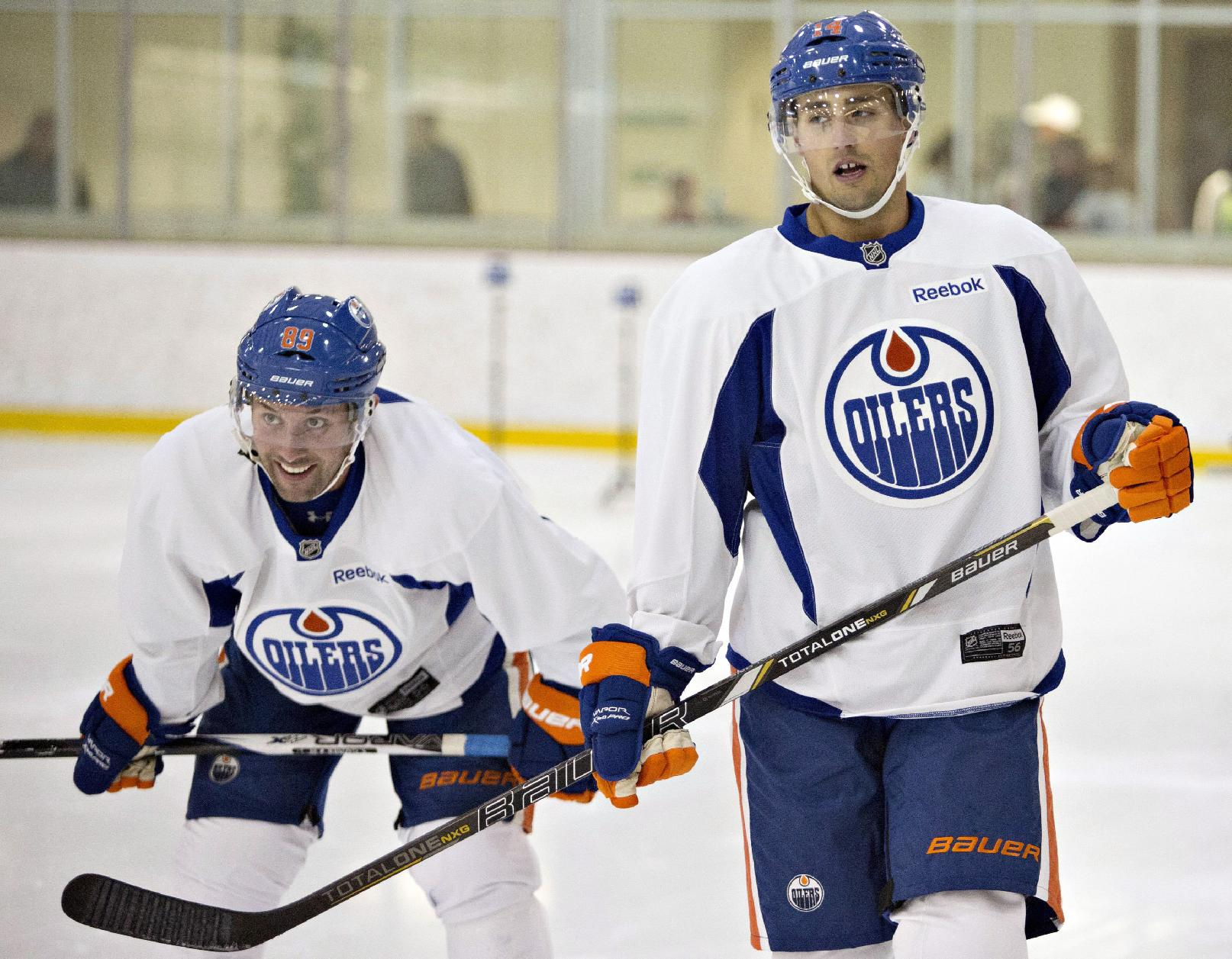 Sam Gagner and Jordan Eberle are a couple of young Oilers who will be looked at to lead the team. (AP)
