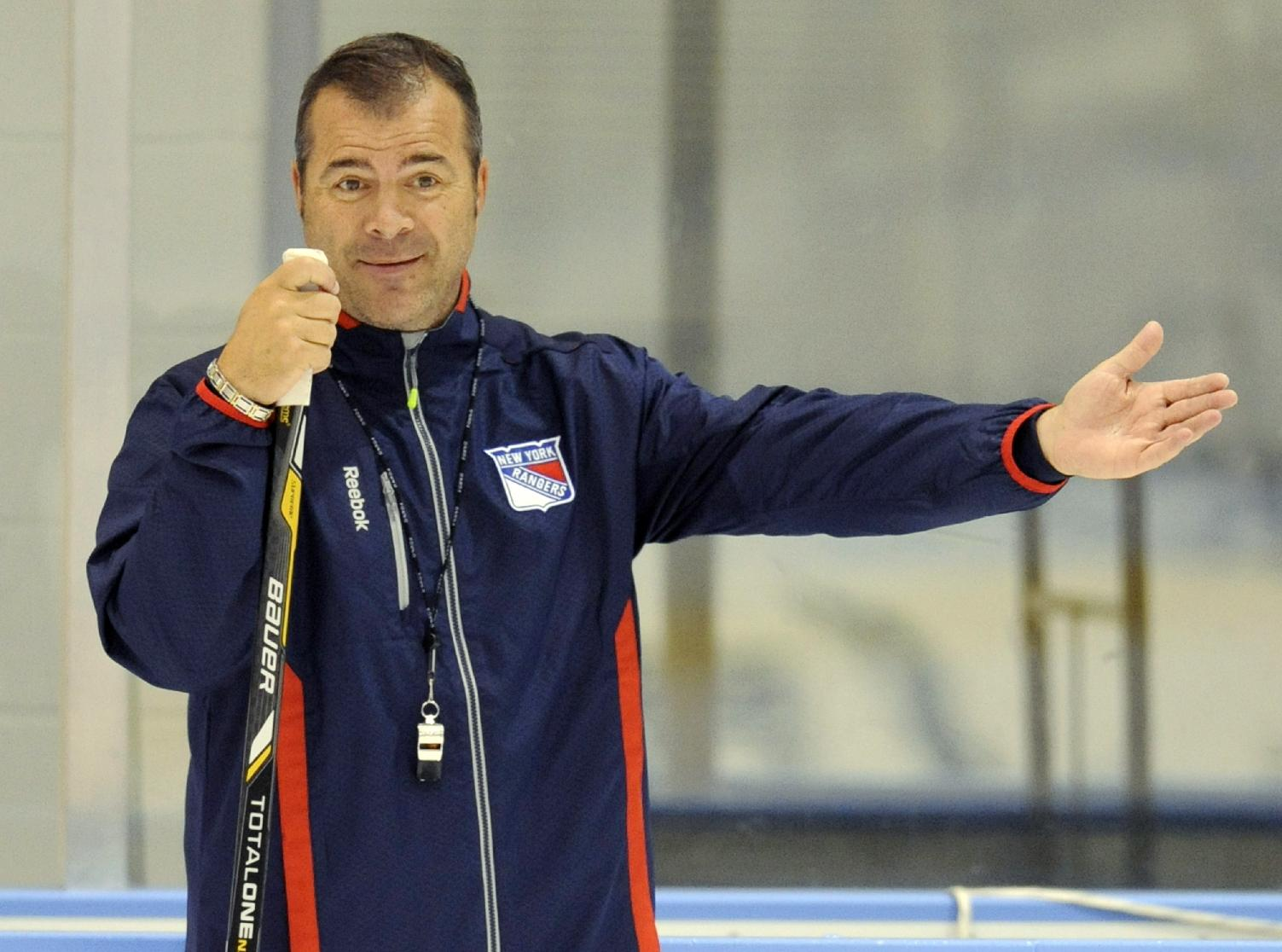 New York Rangers coach Alain Vigneault gestures during NHL hockey training camp Friday, Sept. 13, 2013, in Greenburgh N.Y