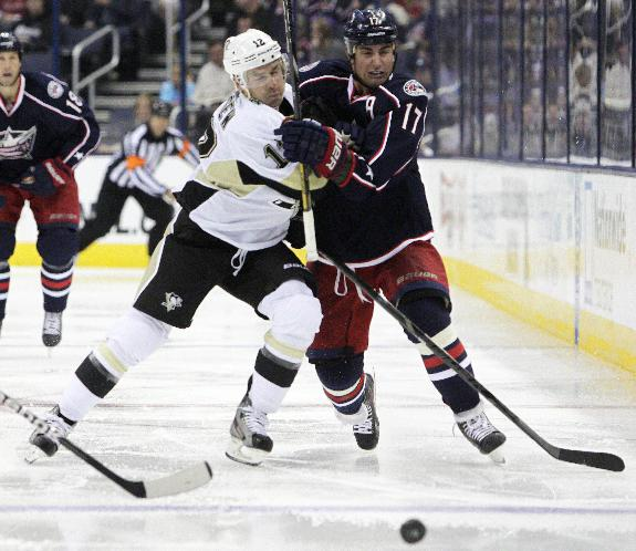Pittsburgh Penguins' Chuck Kobasew, left, and Columbus Blue Jackets' Brandon Dubinsky chase the  loose puck during the second period of an NHL preseason hockey game, Sunday, Sept. 15, 2013, in Columbus, Ohio