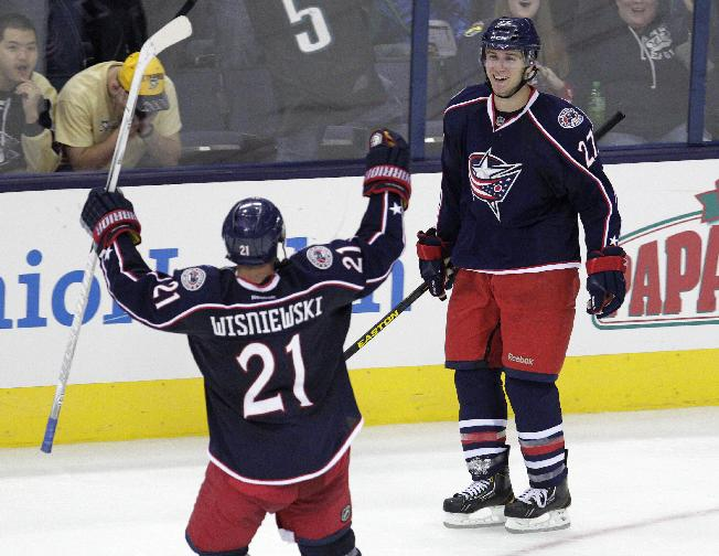 Columbus Blue Jackets' Ryan Murray, right, celebrates his game-winning goal against the Pittsburgh Penguins with teammate James Wisniewski during the overtime period of an NHL preseason hockey game, Sunday, Sept. 15, 2013, in Columbus, Ohio. The Blue Jackets beat the Penguins 5-4