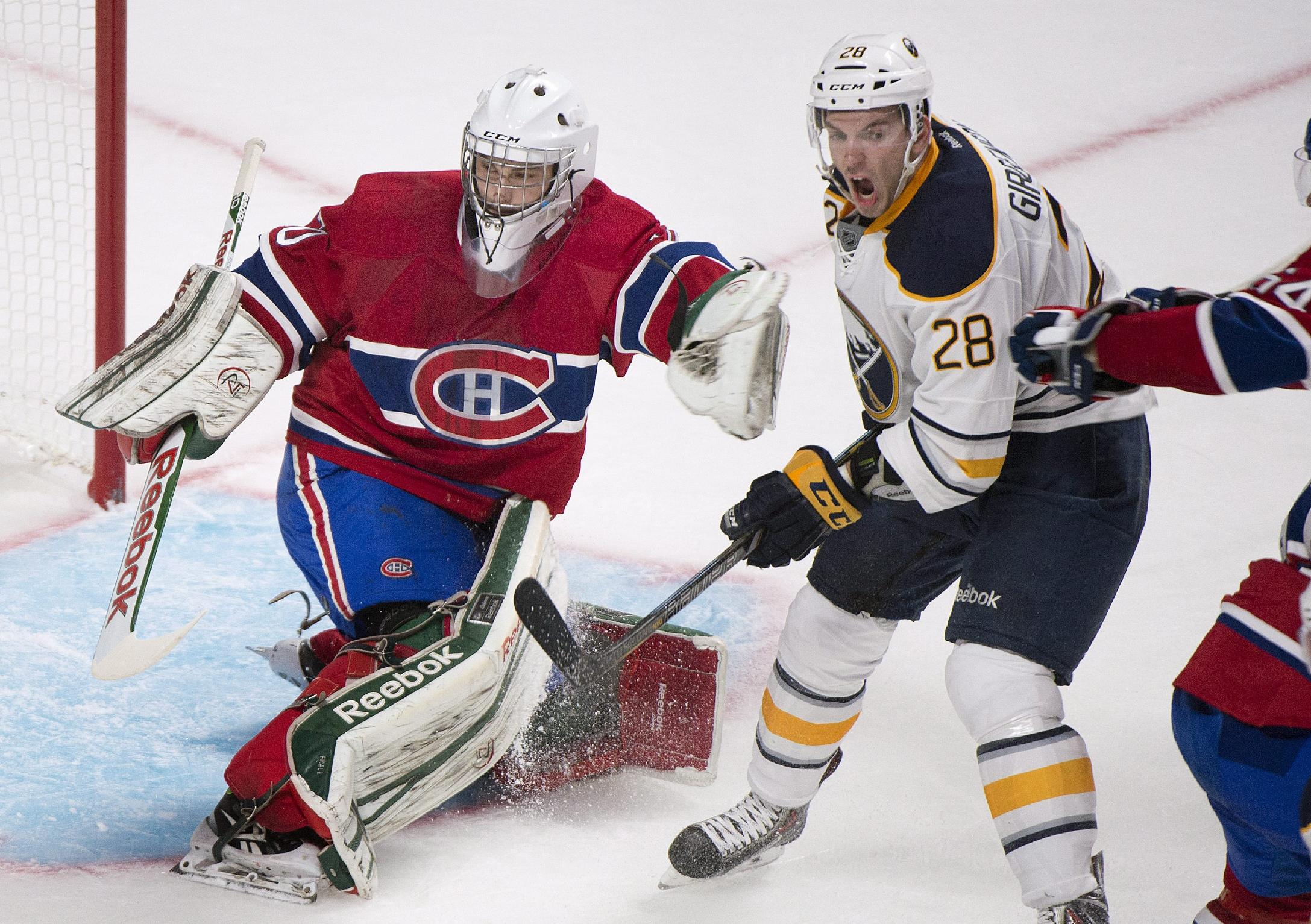 Buffalo Sabres' Zemgus Girgensons (28) moves in on Montreal Canadiens goaltender Zachary Fucale during the second period of an NHL preseason hockey game in Montreal, Sunday, Sept. 15, 2013