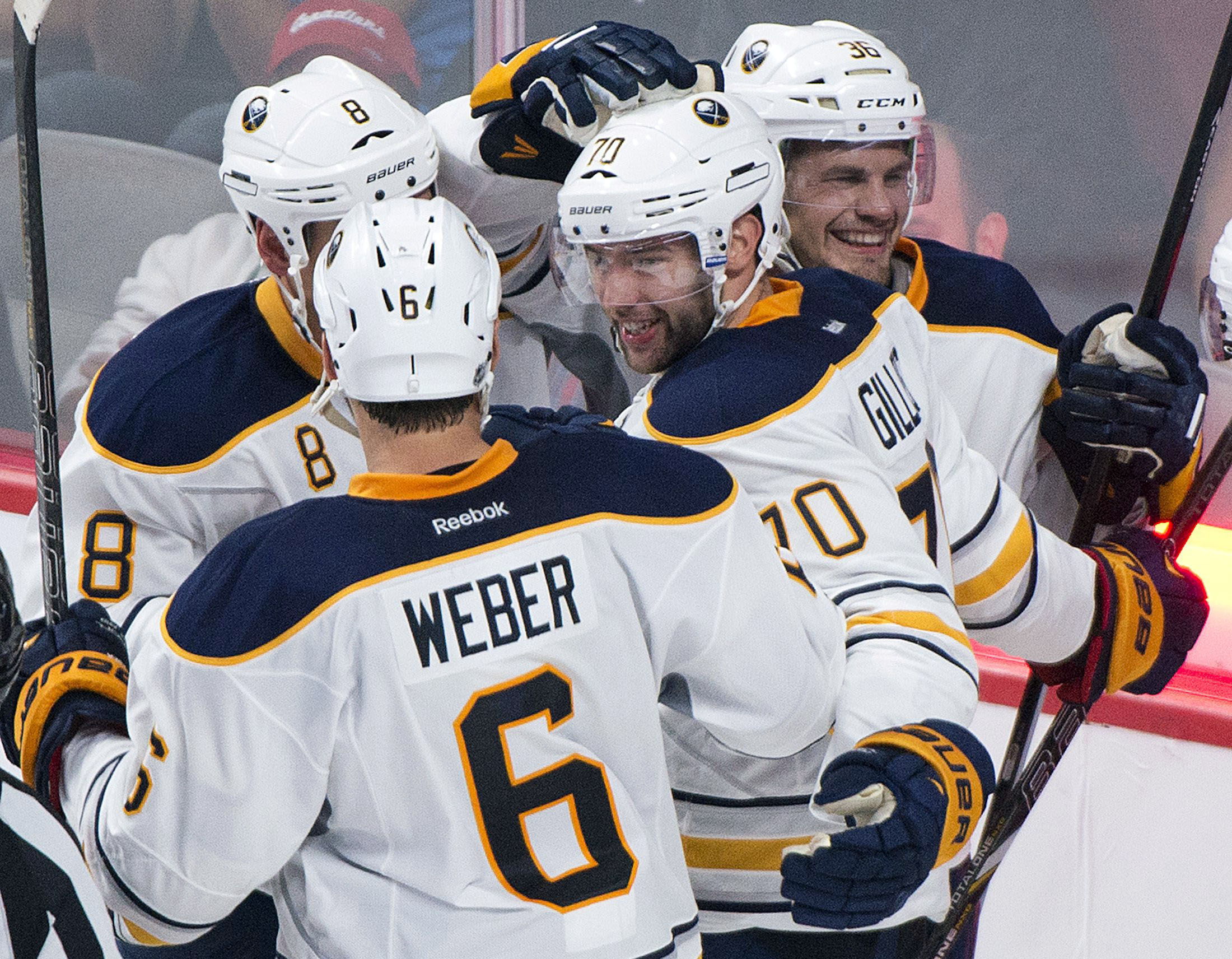 Buffalo Sabres' Colton Gillies (70) celebrates with teammates Mike Weber (6), Cody McCormick (8) and Patrick Kaleta (36) after scoring against the Montreal Canadiens during the third period of an NHL preseason hockey game in Montreal, Sunday, Sept. 15, 2013