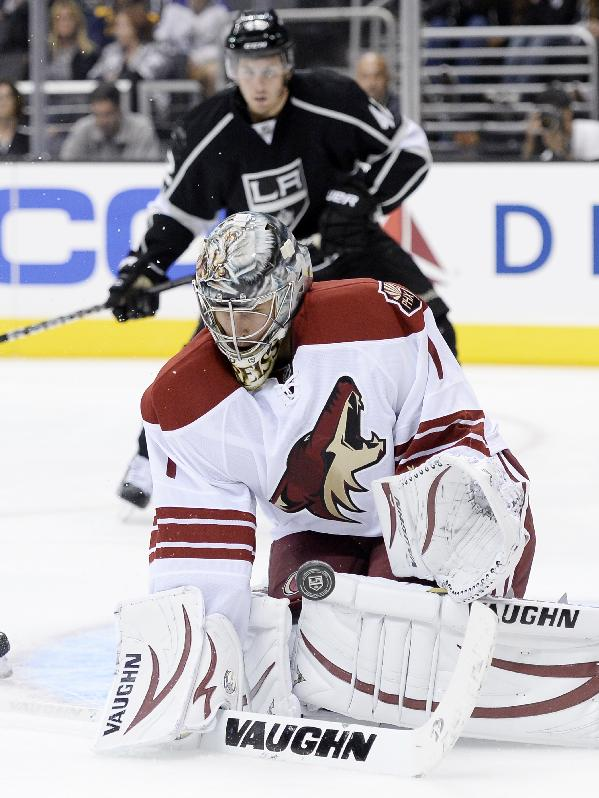Phoenix Coyotes goalkeeper Thomas Greiss (1) stops the puck as he makes a save against Los Angeles Kings during the second period of an NHL hockey game at the Staples Center Sunday, April 15, 2013., in Los Angeles
