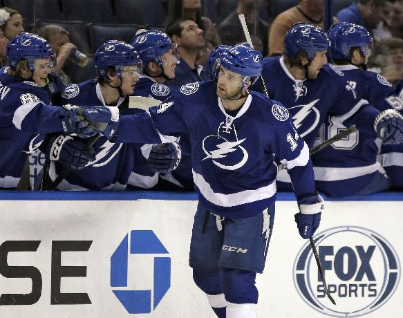 Tampa Bay Lightning right wing Brett Connolly celebrates with the bench after his goal against the Nashville Predators during the first period of an NHL preseason hockey game, Thursday, Sept. 19, 2013, in Tampa, Fla