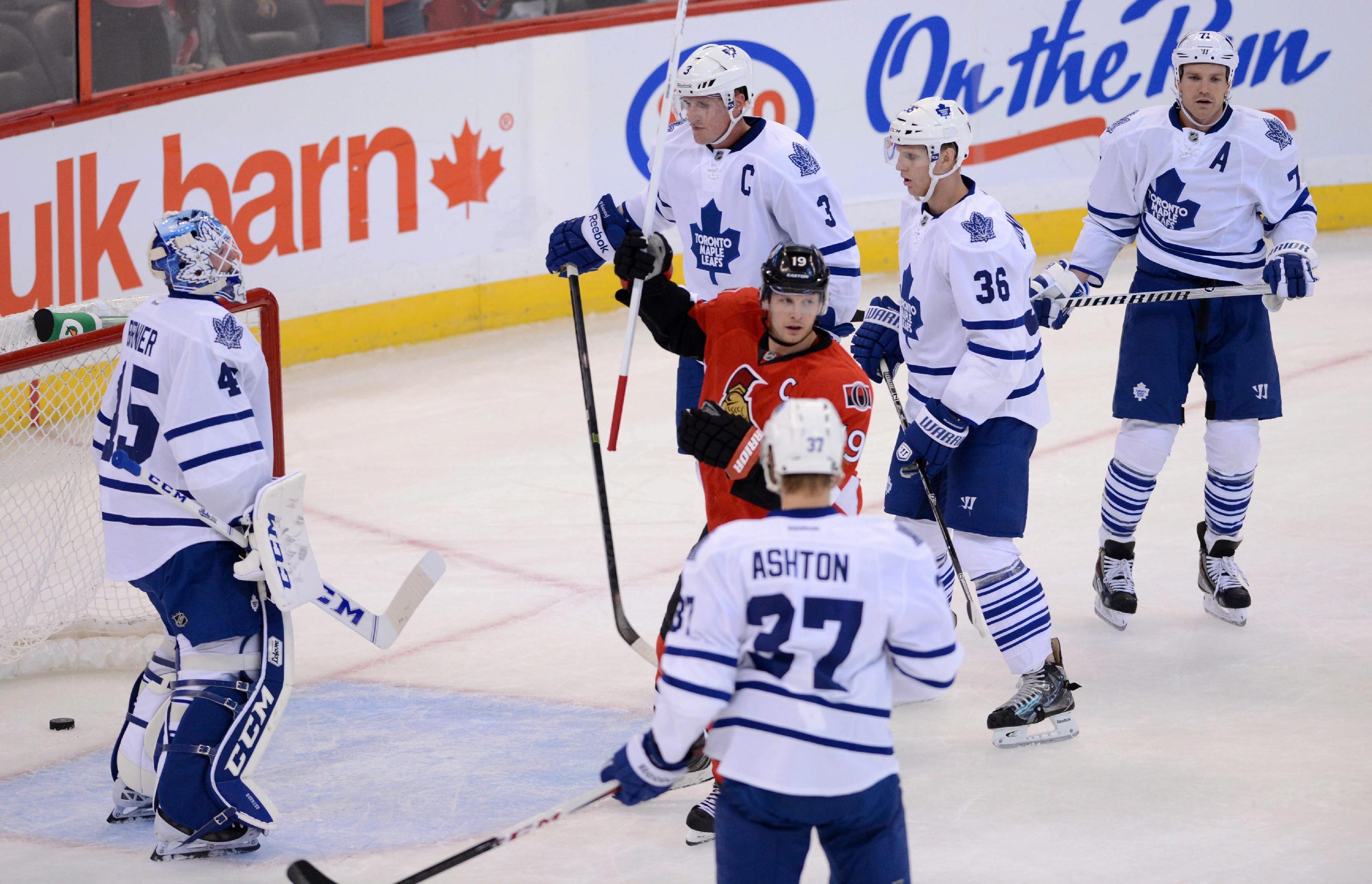 Ottawa Senators' captain Jason Spezza, center, celebrates a goal by teammate Fredrik Claesson against the Toronto Maple Leafs' goaltender Jonathan Bernier, left, during a preseason NHL hockey game in Ottawa, Ontario on Thursday, Sept. 19, 2013