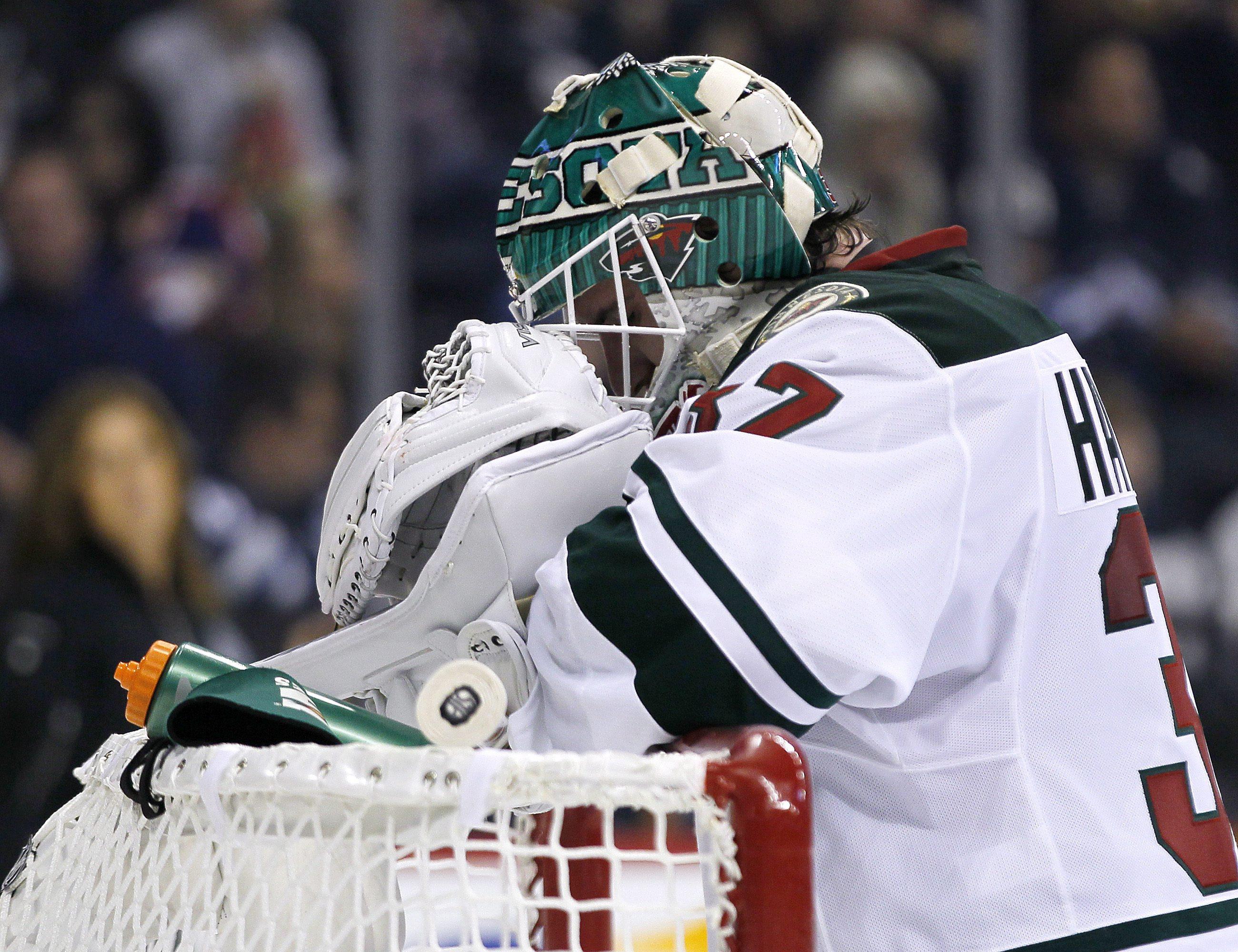 Minnesota Wild goaltender Josh Harding (37) takes a breather during second -period preseason NHL hocky game action against the Winnipeg Jets in Winnipeg, Manitoba, Thursday, Sept. 19, 2013