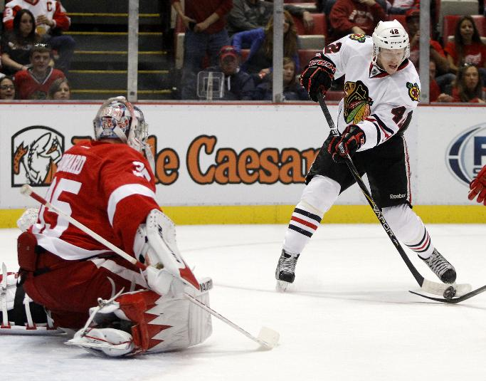 Chicago Blackhawks' Joakim Nordstrom (42), of Sweden, shoots his first period goal against Detroit Red Wings goalie Jimmy Howard (35) during a preseason NHL hockey game Sunday, Sept. 22, 2013 in Detroit