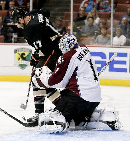 Colorado Avalanche goalie Semyon Varlamov, right, blocks a shot by Anaheim Ducks left wing Dustin Penner during the second period of an NHL preseason hockey game in Anaheim, Calif., Sunday, Sept. 22, 2013