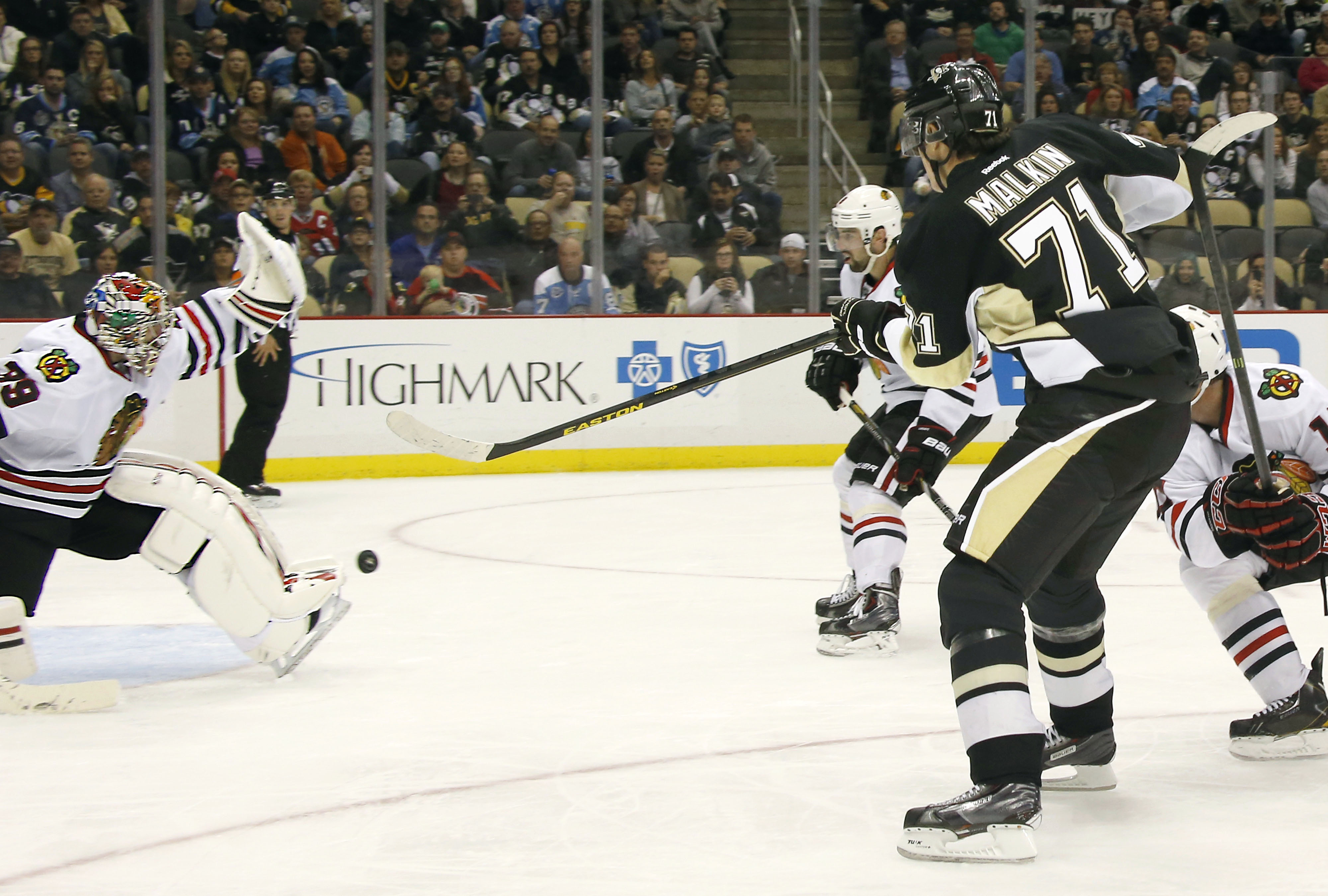 Pittsburgh Penguins' Evgeni Malkin (71), of Russia, has his shot stopped by Chicago Blackhawks goalie Nikolai Khabibulin (39), of Russia, in the second period of an NHL preseason hockey game on Monday, Sept. 23, 2013, in Pittsburgh