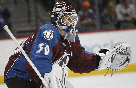 Colorado Avalanche goalie Sami Aittokallio, of Finland, replaces Jean-Sebastien Giguere after giving up four goals to the Dallas Stars in the second period during the second period of an NHL hockey game on Tuesday, Sept. 24, 2013 in Denver
