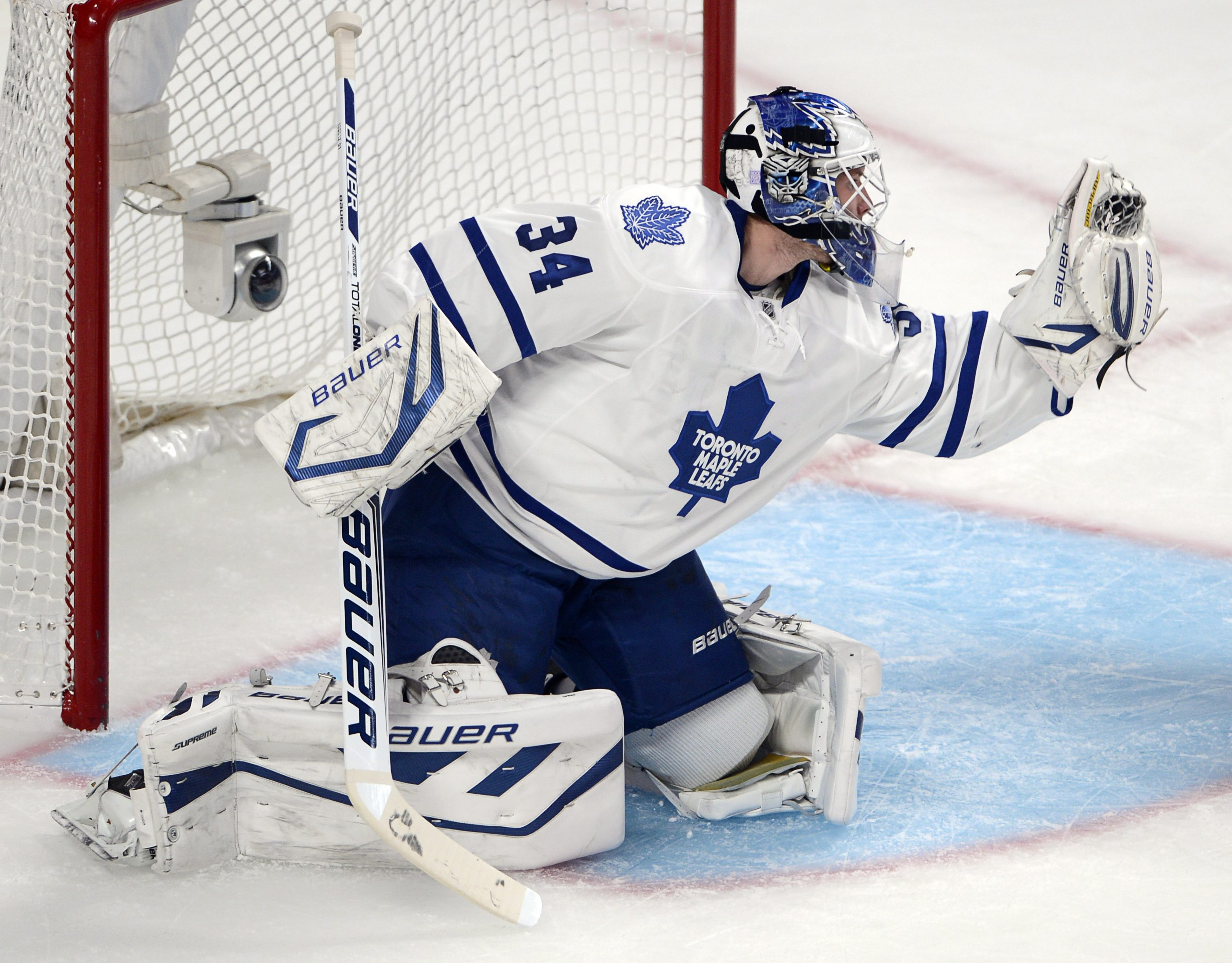 Toronto Maple Leafs goalie James Reimer (34) makes a save against the Montreal Canadiens during first period of an NHL hockey game on Tuesday, Oct. 1, 2013, in Montreal. Toronto won the season opener 4-3