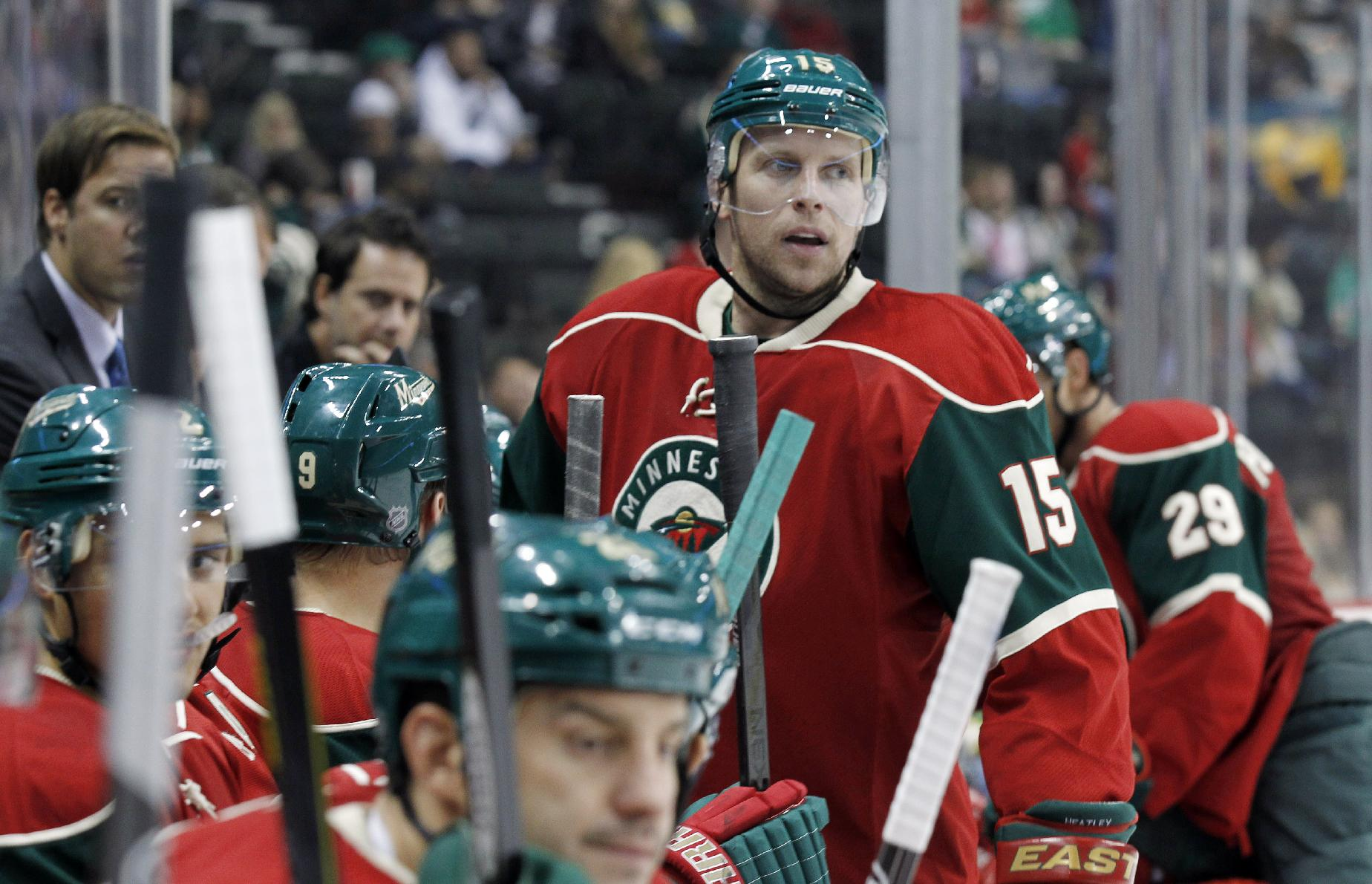 In this Sept. 25, 2013, file photo, Minnesota Wild right wing Dany Heatley (15), sits on the bench during the second period of a preseason NHL hockey game against the St. Louis Blues in St. Paul, Minn. Heatley, once one of the NHL's top goal scorers, has more of a supporting role these days, but the Wild are still counting on him to make some important contributions