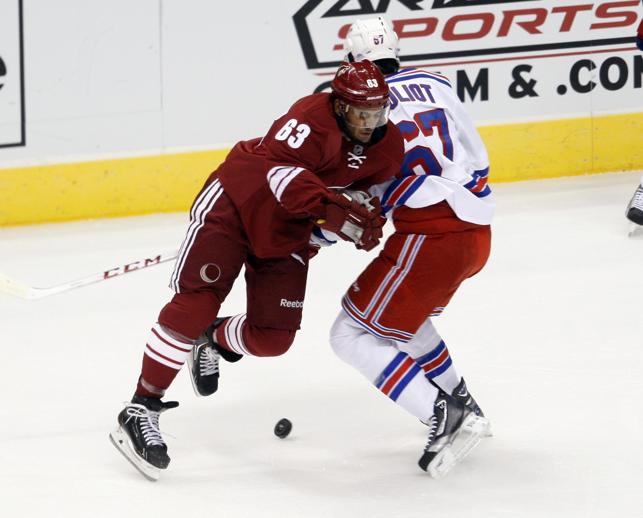 Mike Ribeiro (63) of the Coyotes and Benoit Pouliot (67) of the Rangers collide during the first period of an NHL hockey game Thursday, Oct. 3, 2013, in Glendale, Az
