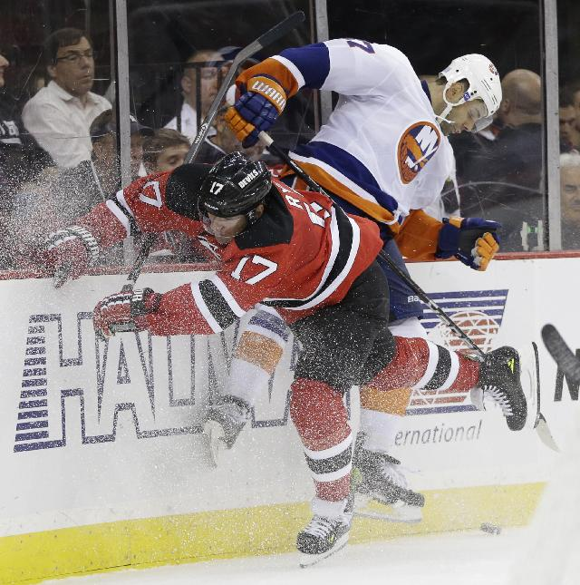 New Jersey Devils' Michael Ryder (17) collides with New York Islanders defenseman Brian Strait while competing for the puck during the second period of an NHL hockey game, Friday, Oct. 4, 2013, in Newark, N.J