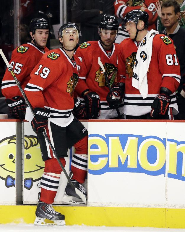 Chicago Blackhawks' Jonathan Toews (19) looks up the big screen after missing a shot against the Tampa Bay Lightning during the shootout of an NHL hockey game in Chicago, Saturday, Oct. 5, 2013. The Lightning won 3-2