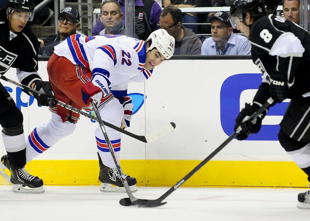 New York Rangers center Brian Boyle (22) and Los Angeles Kings defenseman Drew Doughty (8) vie for the puck during the first period of an NHL hockey game, Monday, Oct. 7, 2013, in Los Angeles
