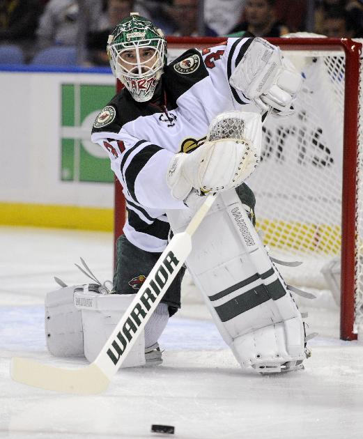 Minnesota Wild goaltender Josh Harding clears the puck during the first period of an NHL hockey game against the Buffalo Sabres in Buffalo, N.Y., Monday, Oct. 14, 2013.  Minnesota won 2-1