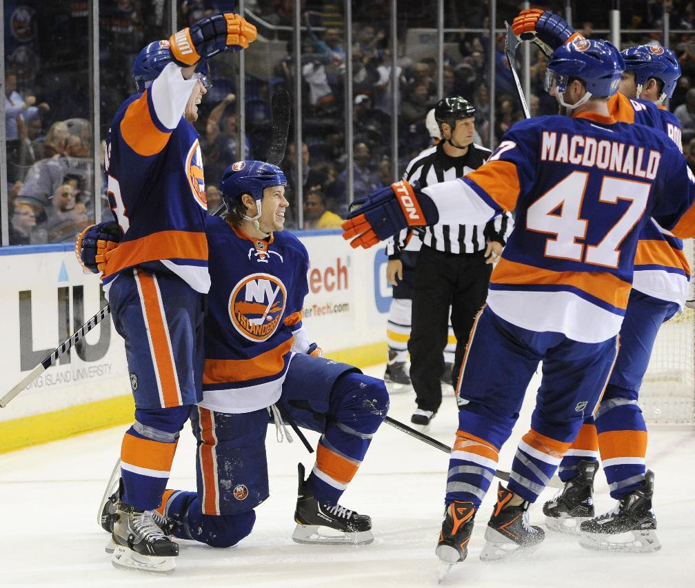 New York Islanders' Casey Cizikas, left, Matt Martin, second from left, Andrew MacDonald (47) and Eric Boulton (36) celebrate Martin's goal against the Buffalo Sabres in the second period of an NHL hockey game on Tuesday, Oct. 15, 2013, in Uniondale, N.Y