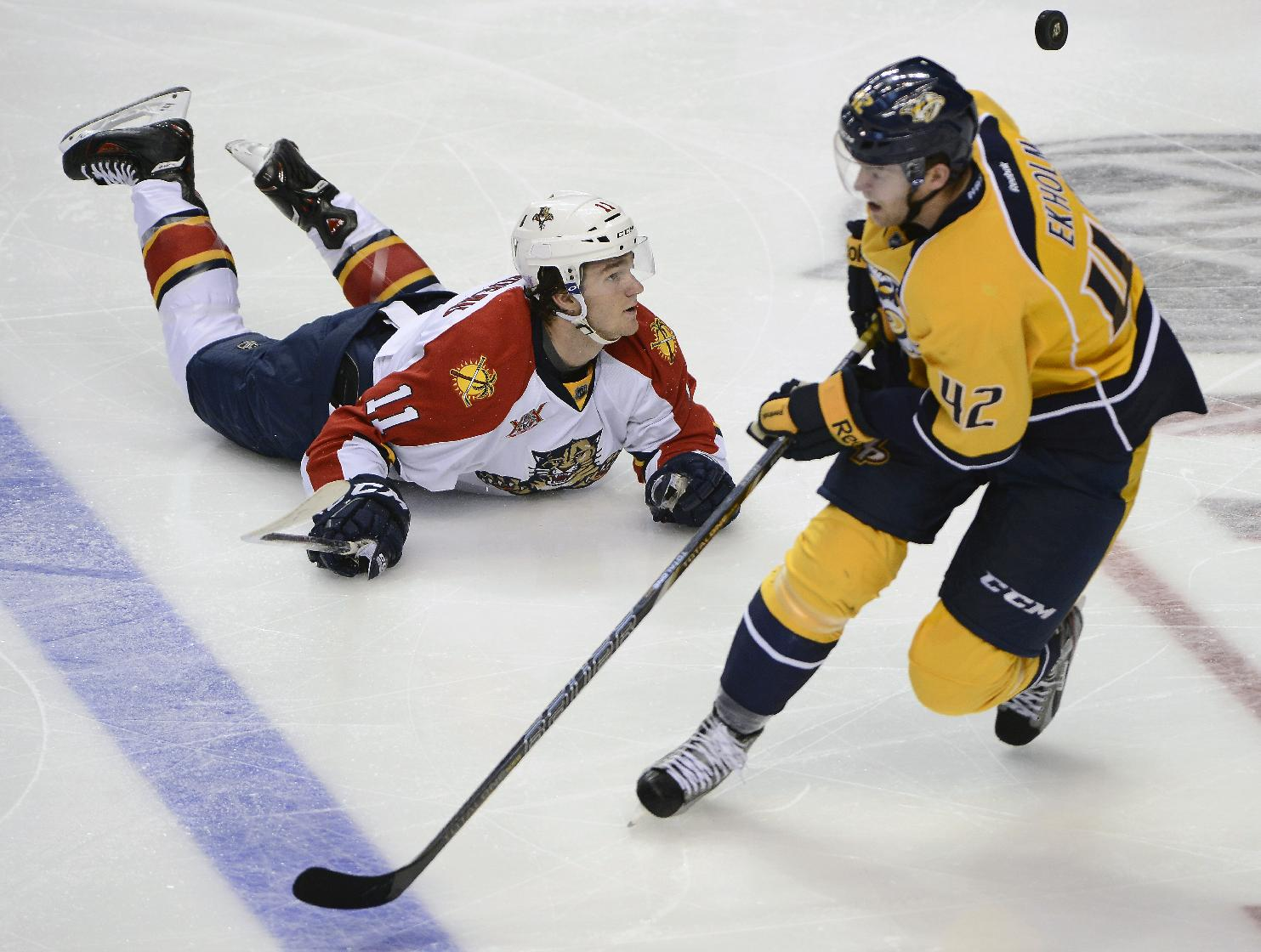 Florida Panthers center Jonathan Huberdeau (11) falls to the ice after Nashville Predators defenseman Jonathan Huberdeau, of Sweden, knocked the puck away in the second period of an NHL hockey game on Tuesday, Oct. 15, 2013, in Nashville, Tenn