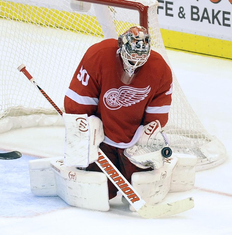 Detroit Red Wings goalie Jonas Gustavsson, of Swede, stops a shot against the Columbus Blue Jackets during the third period of an NHL hockey game Tuesday, Oct. 15, 2013, in Detroit