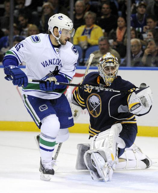 Vancouver Canucks right winger Brad Richardson (15) scores over Buffalo Sabres goaltender Ryan Miller (30) during the second period of an NHL hockey game in Buffalo, N.Y., Thursday, Oct. 17, 2013
