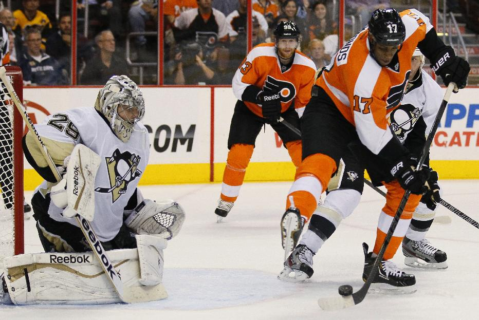 Philadelphia Flyers' Wayne Simmonds, right, directs the puck toward Pittsburgh Penguins goalie Marc-Andre Fleury for a tip-in goal with 2 seconds remaining in the second period of an NHL hockey game, Thursday, Oct. 17, 2013, in Philadelphia