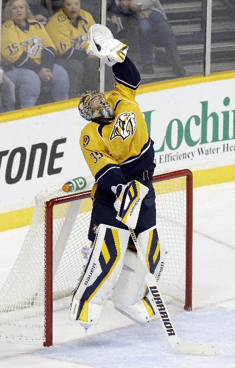 Nashville Predators goalie Pekka Rinne, of Finland, jumps to make a stop against the Los Angeles Kings in overtime at an NHL hockey game Thursday, Oct. 17, 2013, in Nashville, Tenn. The Kings won 2-1 in a shootout