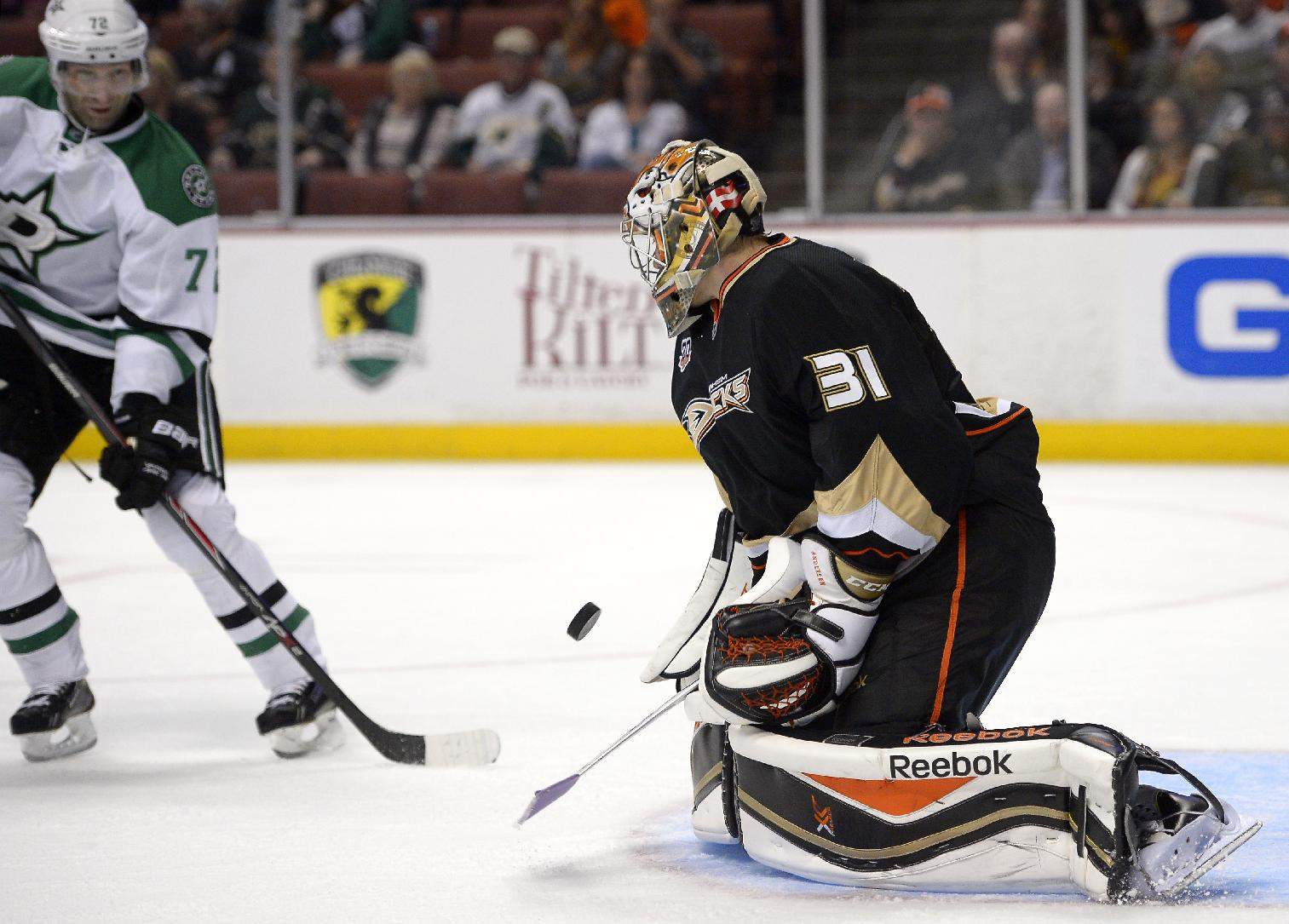 Anaheim Ducks goalie Frederik Andersen, right, stops a shot as Dallas Stars right wing Erik Cole looks on during the third period of their NHL hockey game, Sunday, Oct. 20, 2013, in Anaheim, Calif. The Ducks won 6-3